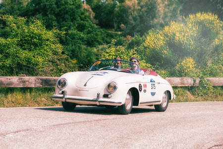 PESARO COLLE SAN BARTOLO, ITALY - MAY 17 - 2018: PORSCHE 356 1500 SPEEDSTER 1955 on an old racing car in the Mille Miglia rally 2018 the famous italian historical race (1927-1957)