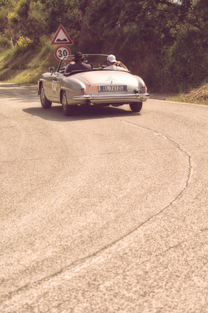 PESARO COLLE SAN BARTOLO, ITALY - MAY 17 - 2018: MERCEDES-BENZ 190 SL 1955 on an old racing car in the Mille Miglia rally 2018 the famous italian historical race (1927-1957) Editorial