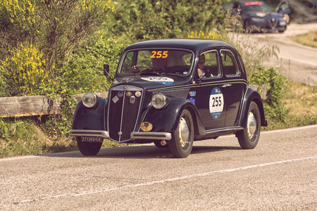 PESARO COLLE SAN BARTOLO, ITALY - MAY 17 - 2018: LANCIA ARDEA 1952 on an old racing car in the rally Mille Miglia 2018 the famous italian historical race (1927-1957)