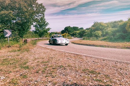 PESARO COLLE SAN BARTOLO , ITALY - MAY 17 - 2018 : PORSCHE 356 1500 SUPER 1953 on an old racing car in rally Mille Miglia 2018 the famous italian historical race (1927-1957)