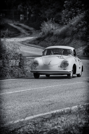 PESARO COLLE SAN BARTOLO, ITALY - MAY 17 - 2018: PORSCHE 356 1500 SUPER 1953 on an old racing car in the rally Mille Miglia 2018 the famous italian historical race (1927-1957) Archivio Fotografico - 119470047