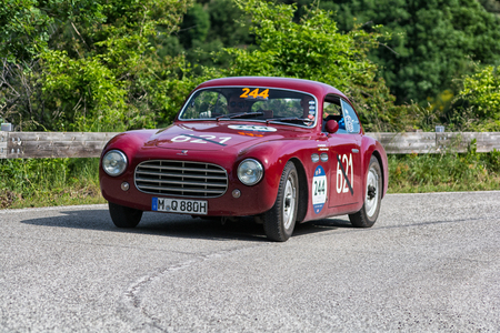 PESARO COLLE SAN BARTOLO , ITALY - MAY 17 - 2018 : CISITALIA 202 D 2800 COUPÉ 1952 on an old racing car in rally Mille Miglia 2018 the famous italian historical race (1927-1957)