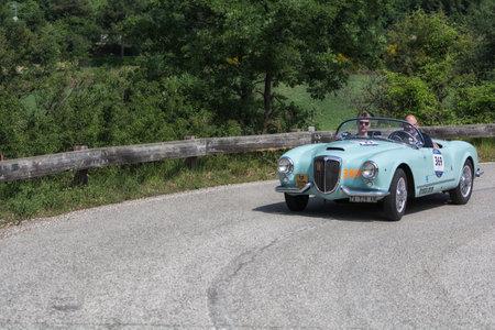 PESARO COLLE SAN BARTOLO , ITALY - MAY 17 - 2018 : LANCIA AURELIA B24 S 1955 on an old racing car in rally Mille Miglia 2018 the famous italian historical race (1927-1957)