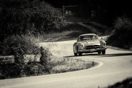 PESARO COLLE SAN BARTOLO , ITALY - MAY 17 - 2018 : MERCEDES-BENZ 300 SL COUPÉ (W198) 1955 on an old racing car in rally Mille Miglia 2018 the famous italian historical race (1927-1957) 에디토리얼