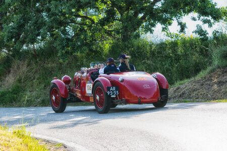 PESARO COLLE SAN BARTOLO, ITALY - MAY 17 - 2018: ASTON MARTIN 2 LITER SPEED MODEL 1936 on an old racing car in the Mille Miglia rally 2018 the famous italian historical race (1927-1957)