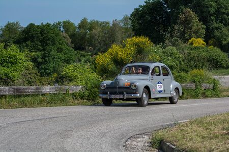PESARO COLLE SAN BARTOLO, ITALY - MAY 17 - 2018: PEUGEOT 203 195 on an old racing car in rally Mille Miglia 2018 the famous italian historical race (1927-1957)