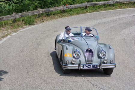 PESARO COLLE SAN BARTOLO , ITALY - MAY 17 - 2018 : JAGUAR XK 140 OTS SE 1955 on an old racing car in rally Mille Miglia 2018 the famous italian historical race (1927-1957)