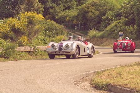 PESARO COLLE SAN BARTOLO , ITALY - MAY 17 - 2018 : JAGUAR XK 120 OTS 1951 racing car in rally Mille Miglia 2018 the famous italian historical race (1927-1957)