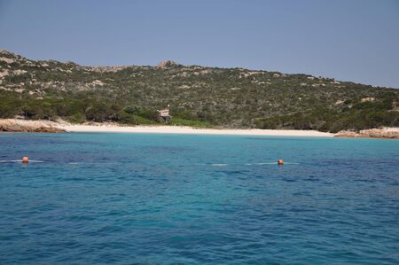Amazing azure sea water on pink beach maddalena budelli island in Sardinia, Italy