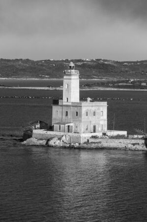A view of lighthouse in Olbia gulf on sunset hour