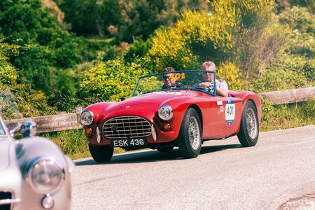 PESARO COLLE SAN BARTOLO, ITALY - MAY 17 - 2018: AC ACE 1955 on an old racing car in rally Mille Miglia 2018 the famous italian historical race (1927-1957) 報道画像