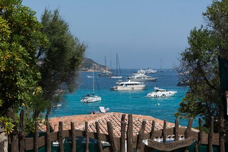Porto Cervo sardinia, august13, 2019: Panoramic view of small pevero beach with yacht 스톡 콘텐츠 - 133263039