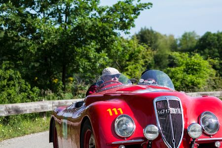 PESARO COLLE SAN BARTOLO, ITALY - MAY 17 - 2018: LANCIA APRILIA 1350 1937 on an old racing car in rally Mille Miglia 2018 the famous italian historical race (1927-1957)