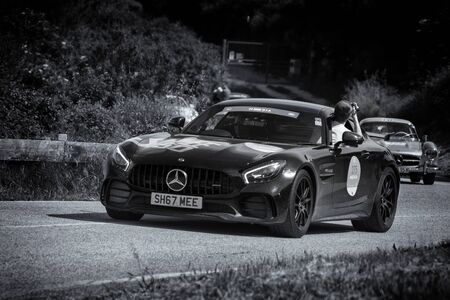 PESARO COLLE SAN BARTOLO, ITALY - MAY 17 - 2018: mercedes AMG GT on an old racing car in rally Mille Miglia 2018 the famous italian historical race (1927-1957)