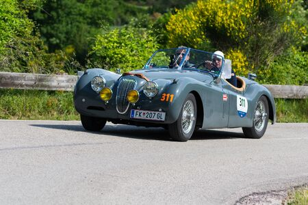 PESARO COLLE SAN BARTOLO , ITALY - MAY 17 - 2018 : JAGUAR XK 120 OTS 1954 on an old racing car in rally Mille Miglia 2018 the famous italian historical race (1927-1957)