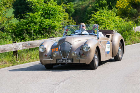 PESARO COLLE SAN BARTOLO, ITALY - MAY 17 - 2018: HEALEY 2400 WESTLAND 1947 on an old racing car in rally Mille Miglia 2018 the famous italian historical race (1927-1957)