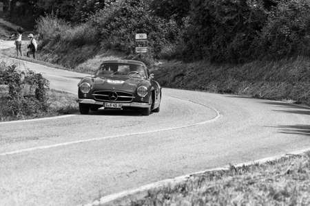 PESARO COLLE SAN BARTOLO, ITALY - MAY 17 - 2018: MERCEDES-BENZ 300 SL COUP? (W198) 1955 on an old racing car in the rally Mille Miglia 2018 the famous italian historical race (1927-1957)