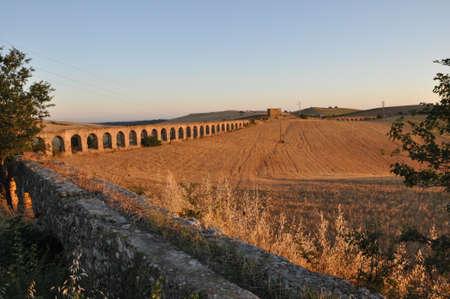 Roman aqueduct ruins in monte romano italy at sunset