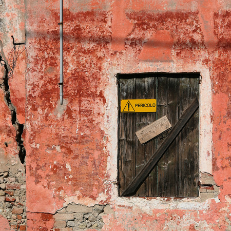 decadent: Old red decadent wall with a closed window