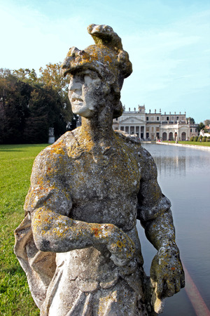 eroded: Statue by the pool in the huge park of Villa Pisani, Italy Stock Photo