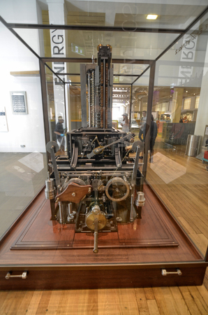 London, United Kingdom, June 2018. Babbage's machine is the progenitor of modern computers. It is a mechanical analogic computer, conserved at the London Science Museum.