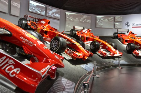 Maranello, Emilia Romagna, Italy. December 2018. At the Ferrari museum, the room where the world-class Formula 1 winning cars are displayed. Videos of those moments flow on a large screen.