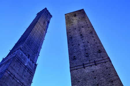 Bologna, Emilia Romagna, Italy. December 2018. The two medieval towers of the city Asinelli, the highest and Garisenda. They are a symbol of the city and a point of reference.
