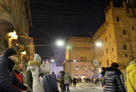 Bologna, Emilia Romagna, Italy. December 2018. Piazza Maggiore from the side of Palazzo Re Enzo. At night, in view of the New Year's party, it is crowded with people. Editorial