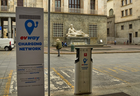 Turin, Piedmont, Italy. April 2018. In the CLN square a charging station for electric cars. In the background the fountain that embodies the river Po Editorial