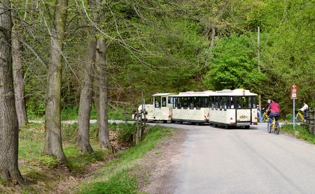 Venaria, Piedmont, Italy. April 2019. Narrow streets of the park crossed by the tourist train Редакционное