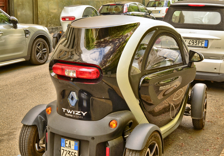 Turin, Piedmont, Italy. May 2019. In the historic center the Renault Twizy: the compactness of this two-seat electric quadricycle facilitates urban mobility. The Z.E. indicates zero emissions. 30Fps.