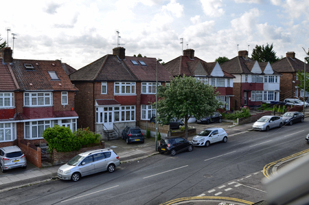 London, United Kingdom, June 2018. The typical London houses of red brick and white finishes, small courtyard on entry. London suburbs, colindale. View from inside the house.