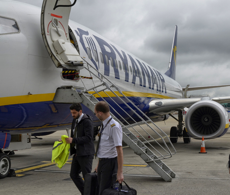 Stansted airport, United Kingdom. June 14, 2018. After the landing of the Ryanair aircraft, once the passengers get out, even the pilot and the co-pilot move away from the aircraft.