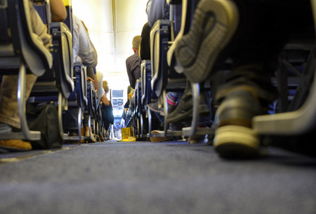Caselle Airport, province of Turin, Piedmont region, Italy. June 14 2018. Internal view of the Ryanair flight to London Stansted airport. Passengers are seated waiting for take-off. Editorial