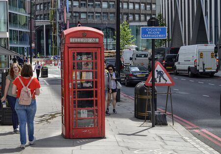 London, United Kingdom, June 2018. Londons telephone booths are one of the citys symbols. Classically of strictly red color. More rarely in black.