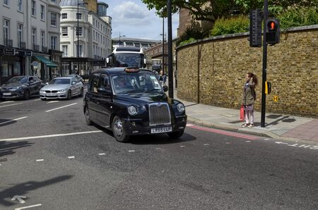London, United Kingdom, June 2018. London taxis, called cabs, are one of the symbols of the city. Classically of strictly black color. Sometimes with colorful sponsorships. Redactioneel