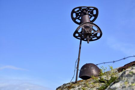 Vinadio, Piedmont, Italy.July 2019. A memorial dedicated to those killed in the Second World War, made with objects from the time. In evidence rusty barbed wire and parts of bombs exploded Stok Fotoğraf