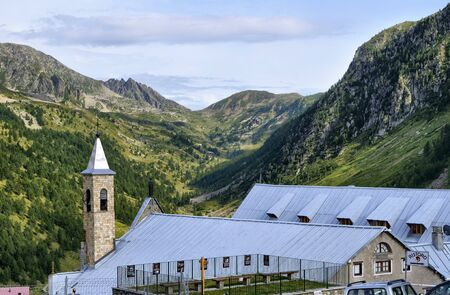 Sant'Anna di Vinadio, Piedmont, Italy. July 2019. View from above behind the Sanctuary and the accommodation facility for the faithful. In the background the enchanting Maritime Alps.