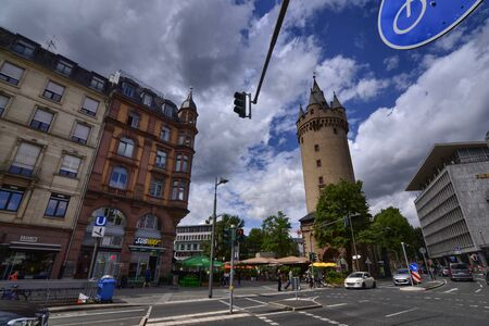 Frankfurt am Main, Germany. August 2019. The Eschenheim Tower is one of the gates of the medieval city. Compared to the modern surrounding architecture it stands out greatly.