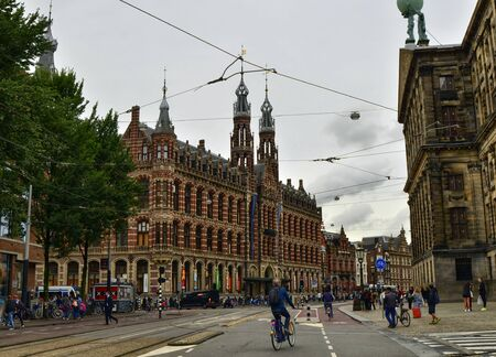 Amsterdam, Holland, August 201. Exterior view from the street of the Magna Plaza shopping center. Red brick neo-gothic building, people are on the street. Editorial