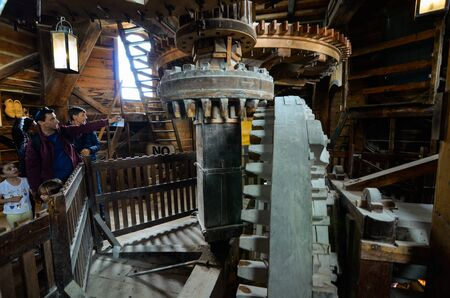 Zaanse Schans,Holland,August 2019. Northeast of Amsterdam is a small community on the Zaan River. Visiting the inside of the mills we can see the gears and the cogwheels that give movement to the mill Editorial