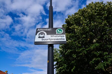 Edam, Netherlands, August 2019. A sign indicating a neighborhood watch is active in the area, using Whatsapp for communication (Dutch: buurtpreventie).