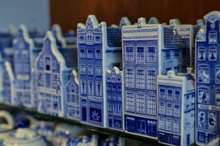 Delft, the netherlands, august 2019. At a shop of the famous blue and white ceramics the typical Dutch miniature houses to buy as souvenirs.
