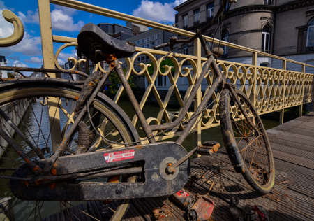 Ghent, Belgium, August 2019. A bike has been fished from the canal: it is rusty and full of dirt. It was left on the deck so that the owner could take it back.