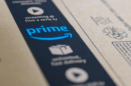 Turin, Piedmont, Italy. April 2020. Quarantine and social distance. The coronavirus causes the delivery of amazon parcels to increase: close-up image on the blue