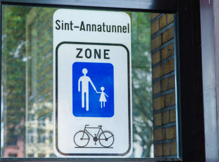 Antwerp, Flanders, Belgium. August 2019. The long pedestrian and cycle tunnel called annatunnel: the signs lead to the entrance.