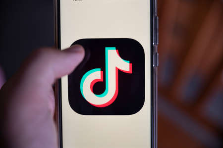 Turin, Piedmont, Italy. July 2020. Close-up image of the smartphone display: the logo of the Tik Tok application is highlighted Redactioneel