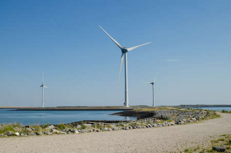 In the Zeeland countryside, wind farms: a particular landscape characterized by wind turbines.