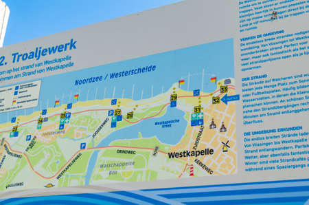 Westkapelle, The Netherlands, August 2019. The beaches of this location are wide and clean: on a beautiful sunny summer day a lot of people enjoy the sea. An information sign for tourists. Redactioneel