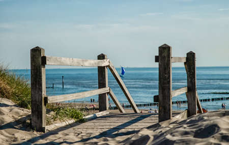 Westkapelle, The Netherlands, August 2019. The beaches of this location are wide and clean: on a beautiful sunny summer day a lot of people enjoy the sea. Stairway access to go down to the beach. Stockfoto
